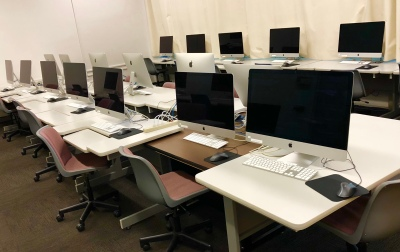 Photo of computers on desks.